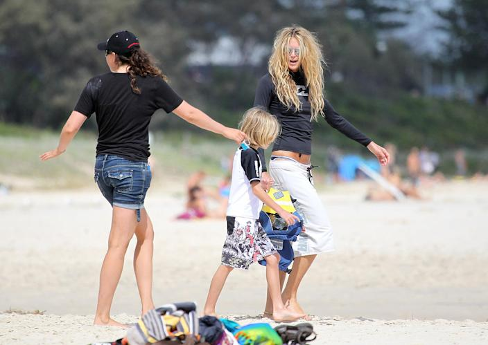 Image: Elle Macpherson enjoyed time with her sons in the beach in Byron Bay, Australia. (Matrix / Getty file)
