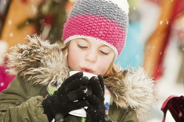 Austria, Salzburg, Girl with cup at christmas market
