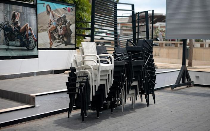 Chairs stacked up outside a closed restaurant in Magaluf - AP