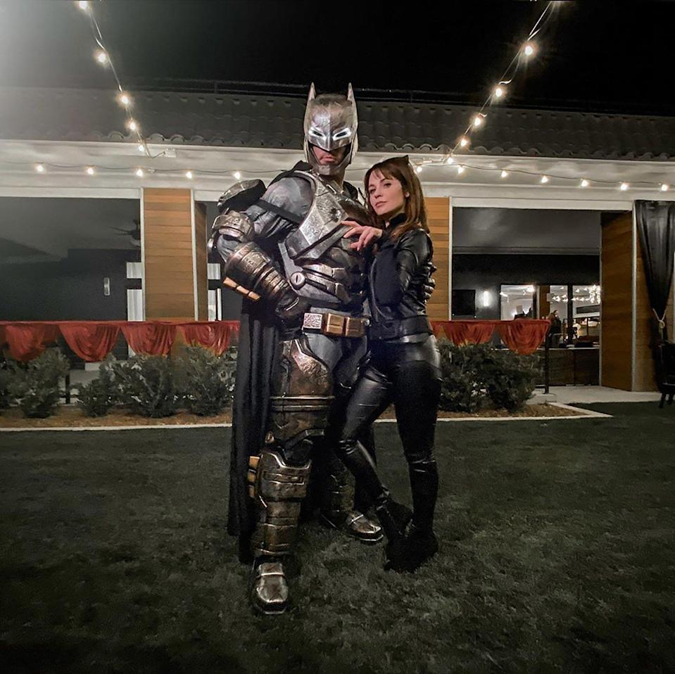 """Batman and Catwoman! The couple dressed up for Drew's brother, J.D. Scott's, <a href=""""https://people.com/home/every-photo-from-property-brothers-j-d-scotts-over-the-top-halloween-wedding/"""" rel=""""nofollow noopener"""" target=""""_blank"""" data-ylk=""""slk:Halloween wedding"""" class=""""link rapid-noclick-resp"""">Halloween wedding</a>. Deschanel <a href=""""https://www.instagram.com/p/B4WMy8iHh7a/?igshid=14iqek0fsukw6"""" rel=""""nofollow noopener"""" target=""""_blank"""" data-ylk=""""slk:captioned the photos"""" class=""""link rapid-noclick-resp"""">captioned the photos</a>, """"It's the first time I've ever been cat-woman escorted to a fancy dress party wedding by Batman. Only for the nuptials of @mrjdscott and @annaleebelle could I be so inspired!"""""""