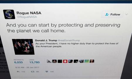 The Twitter account of Rogue NASA is seen replying to a tweet by U.S. President Donald Trump in a photo illustration in Toronto, Ontario, Canada January 26, 2017. REUTERS/Chris Helgren