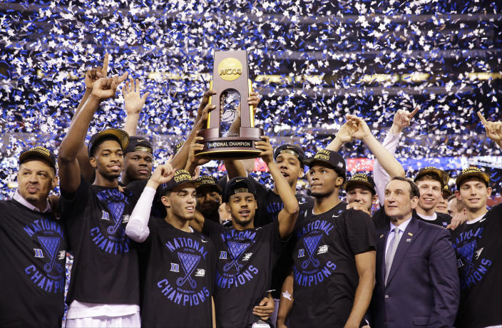FILE - In this April 6, 2015, file photo, Duke players celebrate with the trophy after their 68-63 victory over Wisconsin in the NCAA Final Four college basketball tournament championship game in Indianapolis. (AP Photo/David J. Phillip, File)