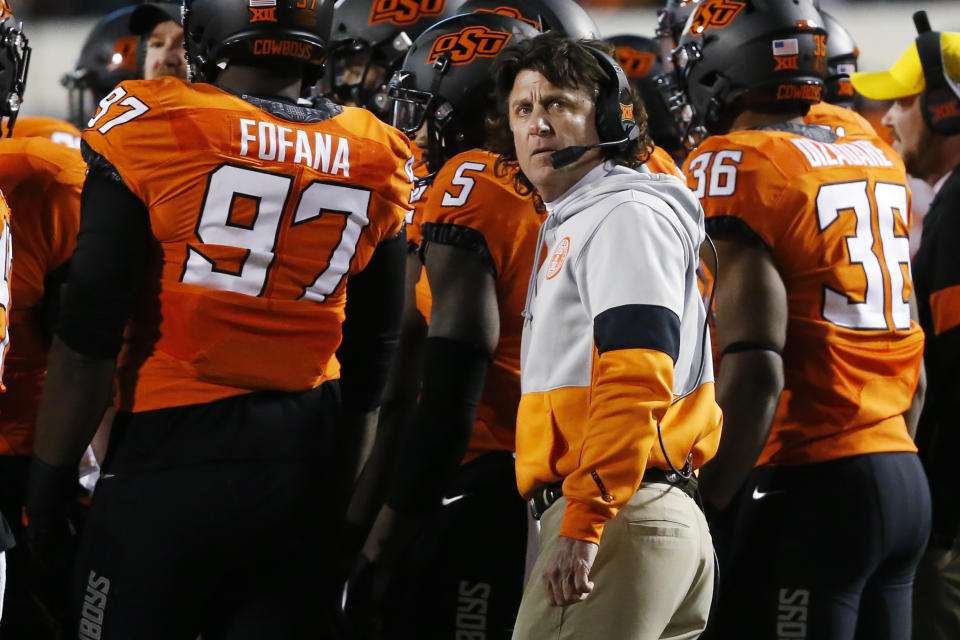 Oklahoma State head coach Mike Gundy looks up at the scoreboard during a timeout in an NCAA college football game against Oklahoma in Stillwater, Okla., Saturday, Nov. 30, 2019. (AP Photo/Sue Ogrocki)