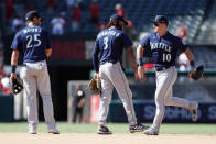 Seattle Mariners' Dylan Moore, left, J.P. Crawford and Jarred Kelenic, right, celebrate the team's 7-4 win in a baseball game against the Los Angeles Angels in Anaheim, Calif., Sunday, July 18, 2021. (AP Photo/Alex Gallardo)