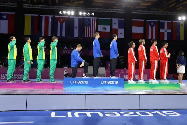 U.S. fencer Race Imboden took a knee during the national anthem at the Pan American Games. (Photo by Leonardo Fernandez/Getty Images)