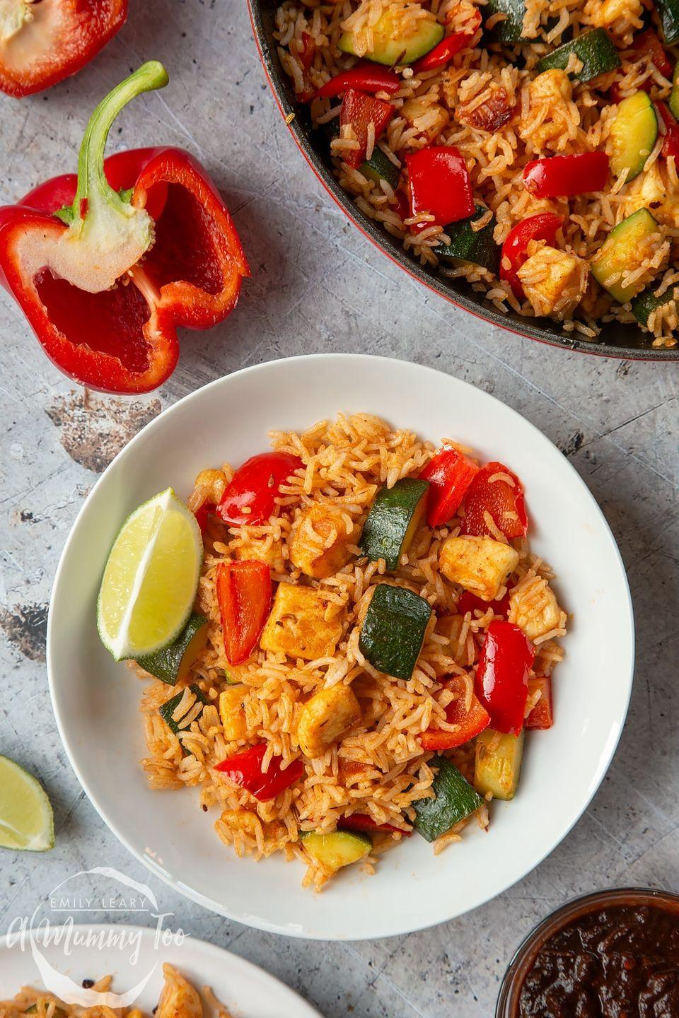 """<p>A simple dish that uses halloumi, peppers and courgette for a combination of spicy, smoky, creamy and salty flavours.</p><p>Get the <a href=""""https://www.amummytoo.co.uk/chilli-bbq-rice-recipe/"""" rel=""""nofollow noopener"""" target=""""_blank"""" data-ylk=""""slk:Spicy BBQ Halloumi Rice"""" class=""""link rapid-noclick-resp"""">Spicy BBQ Halloumi Rice</a> recipe. </p><p>Recipe from <a href=""""https://www.amummytoo.co.uk/"""" rel=""""nofollow noopener"""" target=""""_blank"""" data-ylk=""""slk:A Mummy Too"""" class=""""link rapid-noclick-resp"""">A Mummy Too</a>.</p>"""