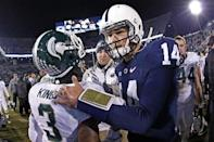 Penn State quarterback Christian Hackenberg (14) walks off the field after visiting with Michigan State receiver Macgarrett Kings Jr. (3) after an NCAA college football game in State College, Pa., Saturday, Nov. 29, 2014. Michigan State won 34-10. (AP Photo/Gene J. Puskar)