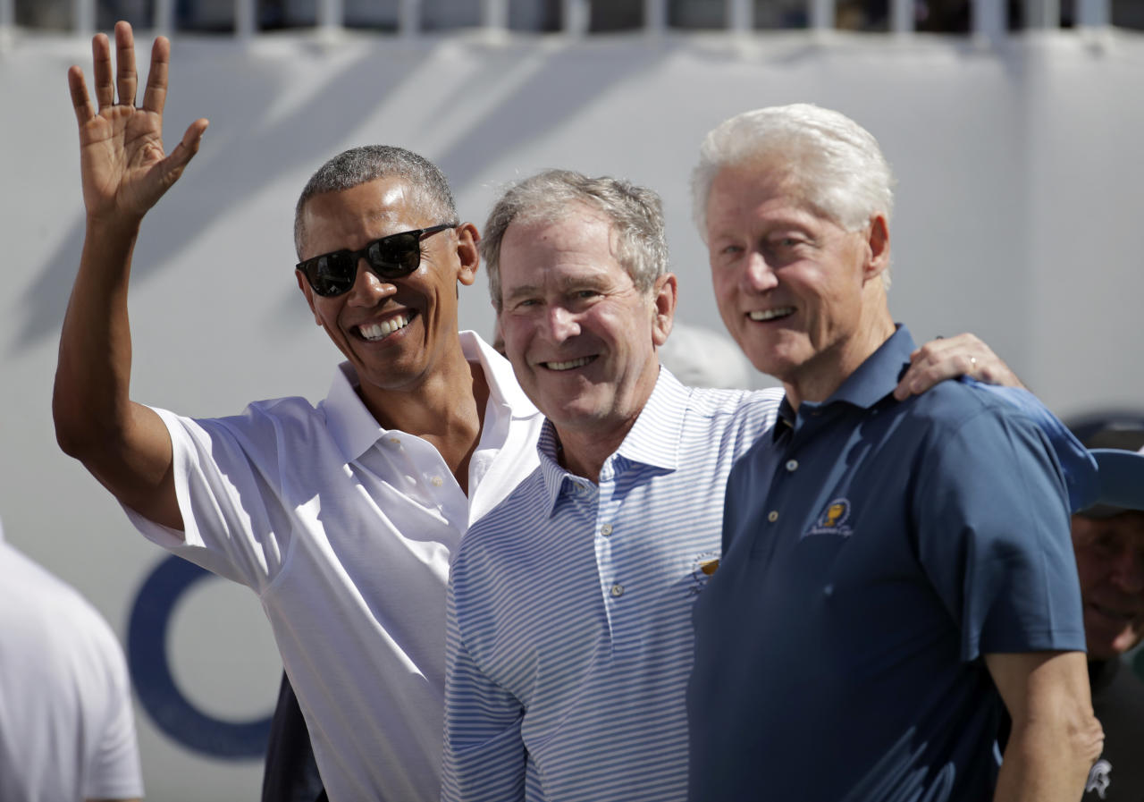 <p>(L-R) Former U.S. Presidents Barack Obama, George W. Bush and Bill Clinton attend the trophy presentation prior to Thursday foursome matches of the Presidents Cup at Liberty National Golf Club on September 28, 2017 in Jersey City, New Jersey. (Photo by Rob Carr/Getty Images) </p>