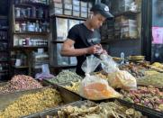 FILE PHOTO: A vendor waits for customers at a herbs and spices market in the old city of Damascus