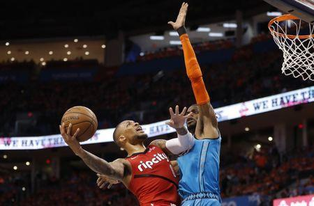 Apr 19, 2019; Oklahoma City, OK, USA; Portland Trail Blazers guard Damian Lillard (0) drives to the basket against Oklahoma City Thunder forward Nerlens Noel (right) defends during the second half in game three of the first round of the 2019 NBA Playoffs at Chesapeake Energy Arena. Mandatory Credit: Alonzo Adams-USA TODAY Sports