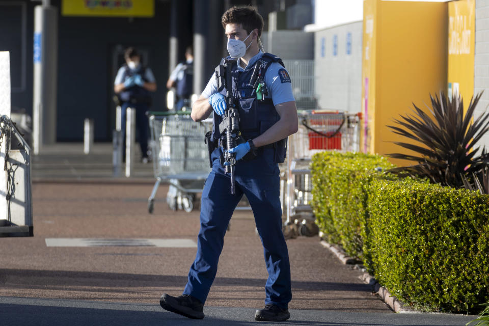 FILE - In this Sept. 4, 2021, file photo, armed police patrol outside a supermarket in Auckland, New Zealand. New Zealand politicians on Thursday, Sept. 30, 2021, passed a law that makes plotting a terrorist attack a crime, fixing a legal loophole that was exposed earlier this month by a violent knife attack. The new law had been months in the planning but was hurried through Parliament after an extremist inspired by the Islamic State group grabbed a knife at the Auckland supermarket on Sept. 3 and began stabbing shoppers. (AP Photo/Brett Phibbs, File)