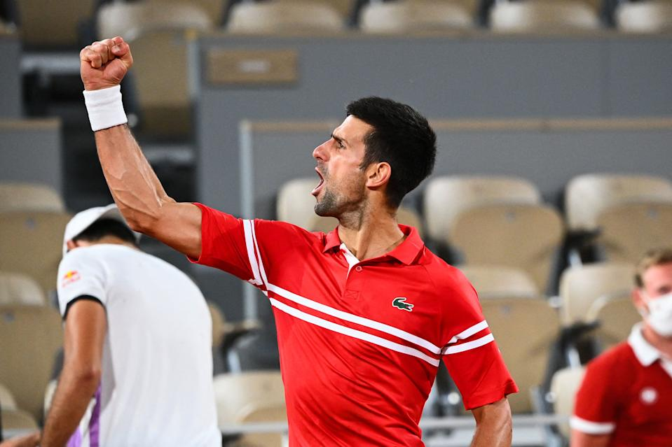 Serbia's Novak Djokovic celebrates after winning against Italy's Matteo Berrettini during their men's singles quarter-final tennis match on Day 11 of The Roland Garros 2021 French Open tennis tournament in Paris on June 9, 2021. (Photo by Anne-Christine POUJOULAT / AFP) (Photo by ANNE-CHRISTINE POUJOULAT/AFP via Getty Images)