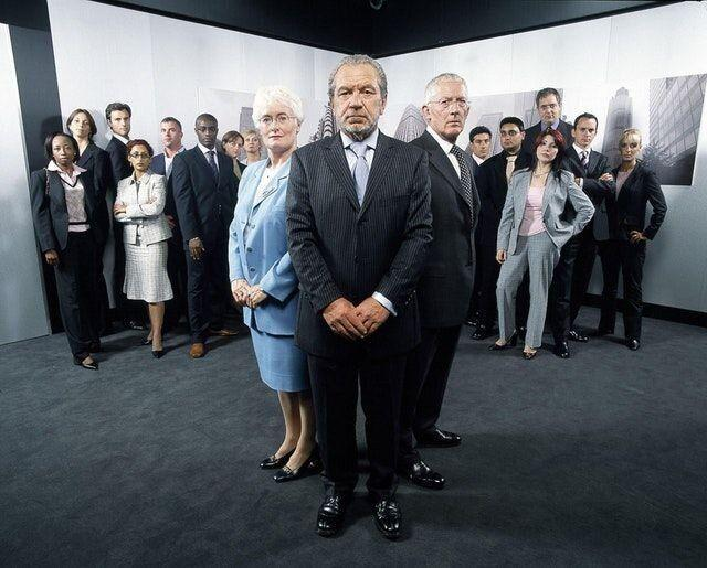 Lord Sugar with aides Margaret Mountford and Nick Hewer and the first-ever Apprentice candidates in 2005 (Photo: BBC)
