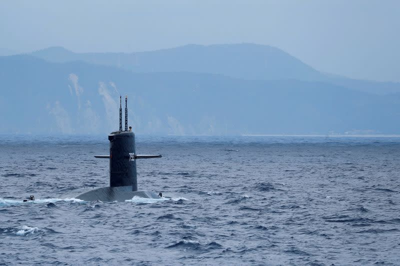 FILE PHOTO: The Hai Lung SS-793 diesel-electric submarine emerges from underwater during a during a drill near Yilan naval base
