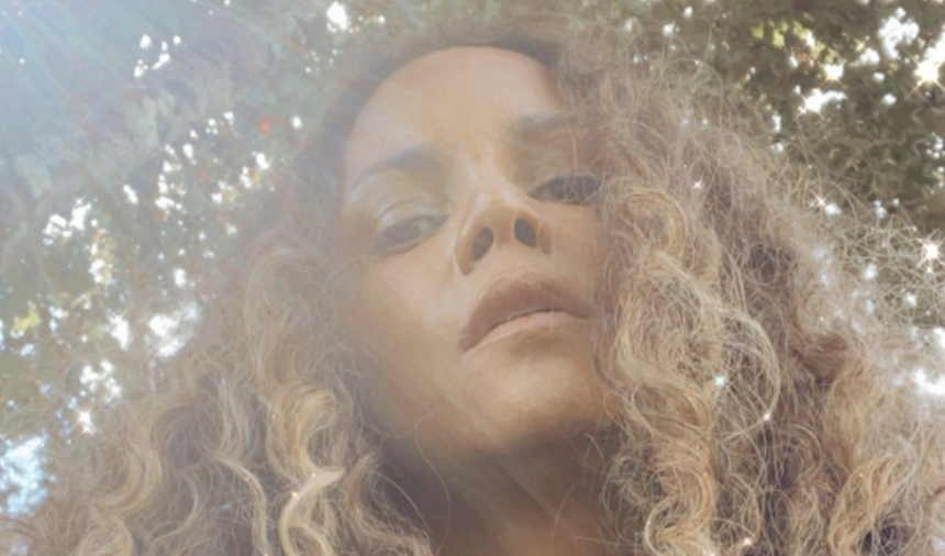 Halle Berry looks radiant as she shows off her long natural hair. (Photo: Instagram)
