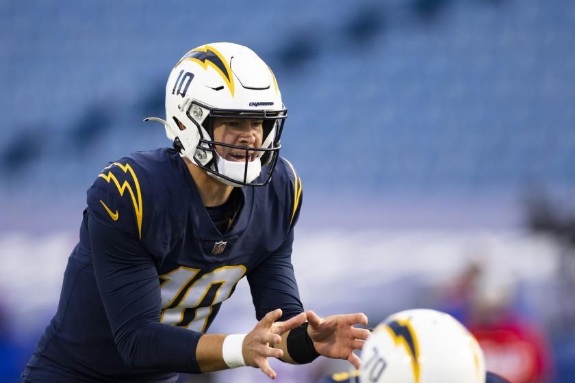 Los Angeles Chargers quarterback Justin Herbert (10) calls for a snap against the Buffalo Bills during the second half of an NFL football game, Sunday, Nov. 29, 2020, in Orchard Park, N.Y. (AP Photo/Brett Carlsen)