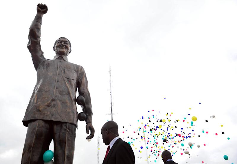 CORRECTS YEAR A giant statue of former president Nelson Mandela after being unveiled on Naval Hill in Bloemfontein, South Africa, Thursday, Dec 13, 2012, by president Jacob Zuma, unseen, ahead of the ruling African National Congress's elective conference. Mandela, who has been hospitalized since the weekend, is recovering from a lung infection. (AP Photo/STR)