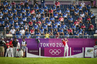 <p>Volunteers watch from the grandstand as Rikuya Hoshino of Team Japan prepares to play his shot on the first tee during the first round of Mens Individual Stroke Play Golf on day six of the Tokyo 2020 Olympic Games on the East Course at Kasumigaseki Country Club on July 29, 2021 in Kawagoe, Saitama, Japan. (Photo by Keyur Khamar/PGA TOUR via Getty Images)</p>