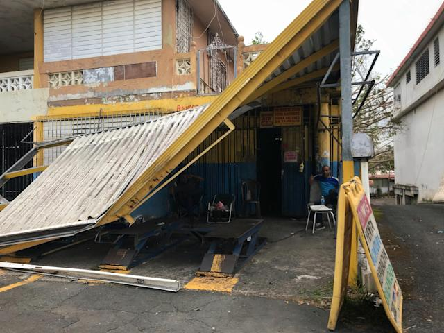 <p>A collapsed roof at a garage in Barceloneta, Puerto Rico after Hurricane Maria. (Photo: Caitlin Dickson/Yahoo News) </p>