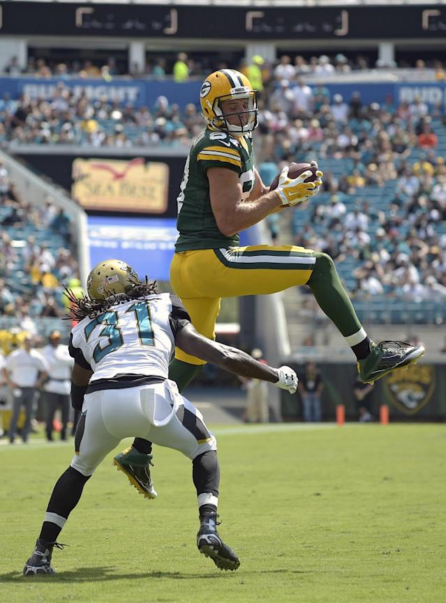 <p>Green Bay Packers wide receiver Jordy Nelson, right, catches a pass in front of Jacksonville Jaguars cornerback Davon House (31) during the second half of an NFL football game in Jacksonville, Fla., Sunday, Sept. 11, 2016.(AP Photo/Phelan M. Ebenhack) </p>