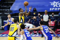 Indiana Pacers' Edmond Sumner, center, goes up for a shot during the first half of an NBA basketball game against the Philadelphia 76ers, Monday, March 1, 2021, in Philadelphia. (AP Photo/Matt Slocum)