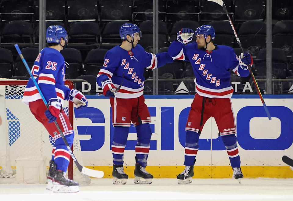 NEW YORK, NEW YORK - APRIL 06: Pavel Buchnevich #89 of the New York Rangers (R) celebrates his goal against the Pittsburgh Penguins at 10:41 of the third period and is joined by Libor Hajek #25 (L) and Filip Chytil #72 (C) at Madison Square Garden on April 06, 2021 in New York City. (Photo by Bruce Bennett/Getty Images)