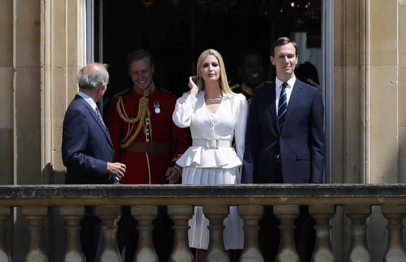 Jared Kushner, right, and Ivanka Trump, second right, watch from a window before a ceremonial welcome in the garden of Buckingham Palace in London for President Donald Trump and first lady Melania Trump, Monday, June 3, 2019 on the opening day of a three day state visit to Britain. (AP Photo/Frank Augstein)