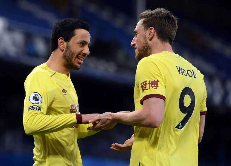 Burnley's boost: Chris Wood (right) and Dwight McNeil (left) moved Burnley seven points clear of the relegation zone