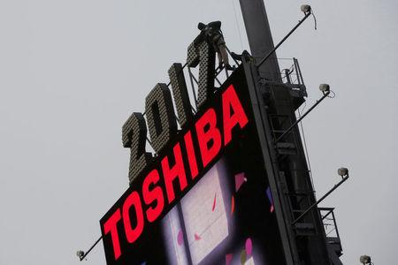 FILE PHOTO - Workers prepare the new year's eve numerals above a Toshiba sign in Times Square in Manhattan, New York City, U.S.