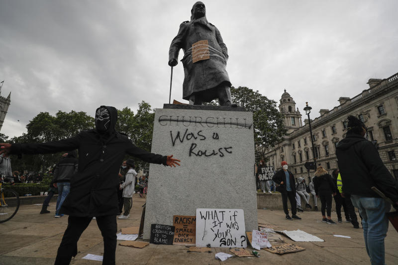 Protesters gather around Winston Churchill statue in Parliament Square during the Black Lives Matter protest rally in London, Sunday, June 7, 2020, in response to the recent killing of George Floyd by police officers in Minneapolis, USA, that has led to protests in many countries and across the US. (AP Photo/Frank Augstein)