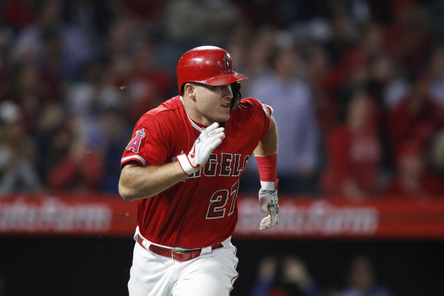 Los Angeles Angels' Mike Trout runs to first base after hitting a two-run single during the fifth inning of the team's baseball game against the Arizona Diamondbacks, Tuesday, June 19, 2018, in Anaheim, Calif. (AP Photo/Jae C. Hong)