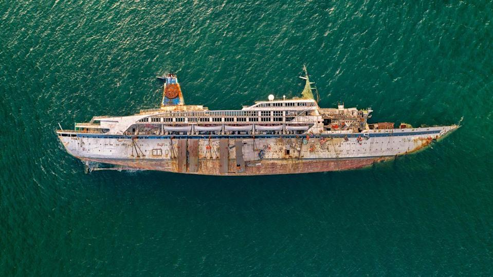 <p>A capsized luxury cruise liner floats off the coast of Thailand.</p>