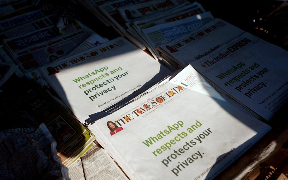 <p>A WhatsApp advertisement on the front pages of newspapers at a stall in Mumbai, India, on 13 January, 2021</p> (REUTERS)