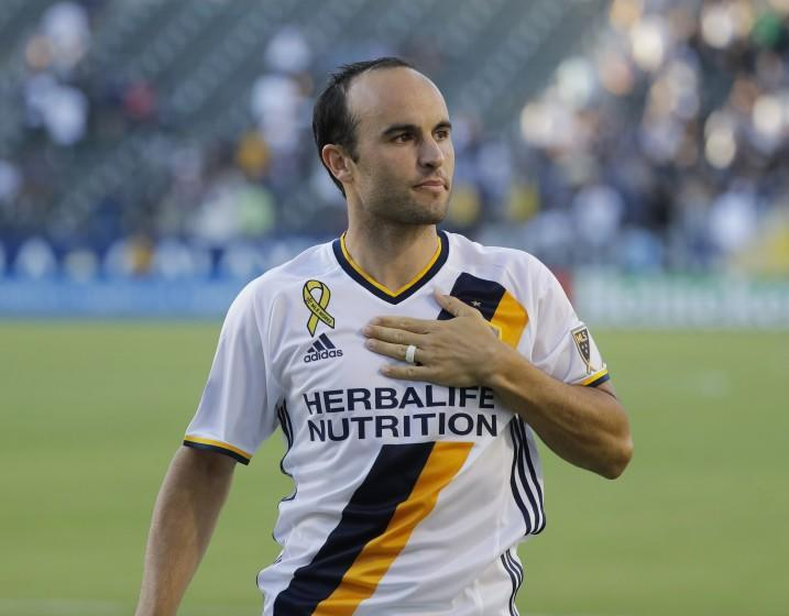 FILE - In this Sept. 11, 2016, file photo, Los Angeles Galaxy's Landon Donovan acknowledges fans after the team's MLS soccer match against Orlando City in Carson, Calif. Donovan knew what had to be done even if meant bringing a startling end to his first season as coach of the expansion San Diego Loyal soccer team. The Loyal forfeited their final two matches of 2020 to protest alleged slurs directed at players. Donovan begins his second season as coach when San Diego visits Phoenix Rising FC on Friday night. (AP Photo/Jae C. Hong. File)