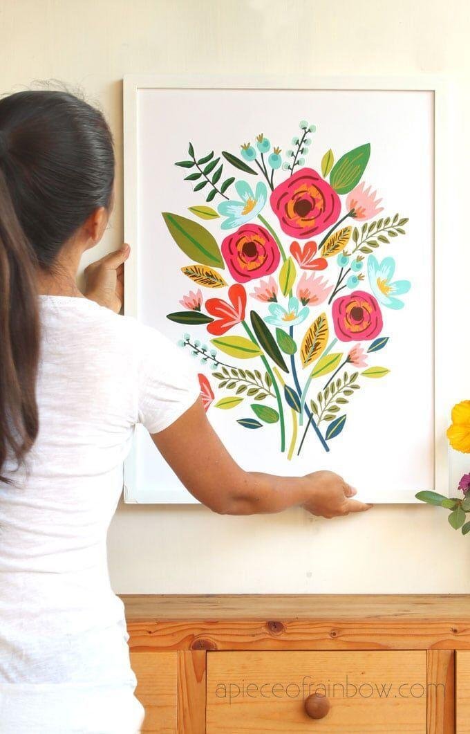 "<p>Starting with free printable flowers, card stock, a large poster board, and frame, this colorful floral wall art will cost you only $5—and only an hour of time!—to make. </p><p><strong>Get the tutorial at <a href=""https://www.apieceofrainbow.com/diy-beautiful-large-wall-art/"" rel=""nofollow noopener"" target=""_blank"" data-ylk=""slk:A Piece of Rainbow"" class=""link rapid-noclick-resp"">A Piece of Rainbow</a>.</strong></p><p><a class=""link rapid-noclick-resp"" href=""https://www.amazon.com/DecoArt-16-Ounce-Decoupage-Matte-Finish/dp/B004VD3JZ0/?tag=syn-yahoo-20&ascsubtag=%5Bartid%7C10050.g.31153820%5Bsrc%7Cyahoo-us"" rel=""nofollow noopener"" target=""_blank"" data-ylk=""slk:SHOP DECOUPAGE GLUE"">SHOP DECOUPAGE GLUE</a></p>"