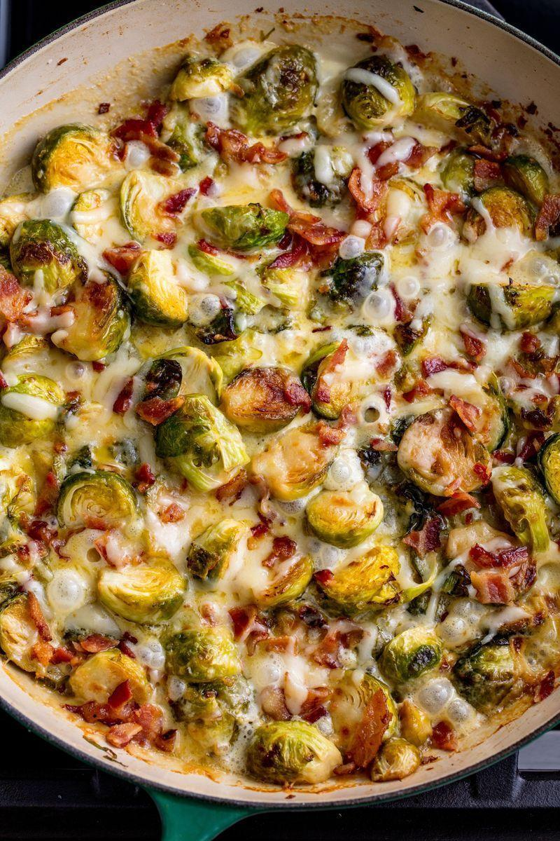 """<p>The one side that will make everyone freak out (and run for seconds). If you have vegetarian guests, feel free to skip the bacon! We're all about the smoky flavour, but for this dish, it's all about the CHEESE. </p><p>Get the <a href=""""https://www.delish.com/uk/cooking/recipes/a28924372/cheesy-brussels-sprout-casserole-recipe/"""" rel=""""nofollow noopener"""" target=""""_blank"""" data-ylk=""""slk:Cheesy Brussels Sprout Bake"""" class=""""link rapid-noclick-resp"""">Cheesy Brussels Sprout Bake</a> recipe.</p>"""