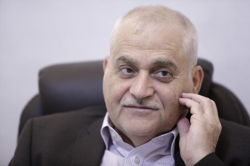 "Lebanese Health Minister Jamil Jabak speaks during an interview at his private clinic in a southern suburb of Beirut, Lebanon, Saturday, May 18, 2019. Jabak says he has ""overcome"" U.S. concerns over the possibility of his ministry's finances going to the Hezbollah militant group, by gaining public trust and ensuring transparency. (AP Photo/Hassan Ammar)"