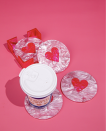 "<p>At your Valentine's Day–themed table, how about a Valentine's Day–themed drink set atop a Valentine's Day–themed coaster? You can never go wrong with pink and red hearts.</p><p>Via <em><a href=""https://edie-parker.com/collections/hvn"" rel=""nofollow noopener"" target=""_blank"" data-ylk=""slk:Edie Parker"" class=""link rapid-noclick-resp"">Edie Parker</a></em></p><p><a class=""link rapid-noclick-resp"" href=""https://edie-parker.com/collections/hvn/products/round-coasters-in-heart-on"" rel=""nofollow noopener"" target=""_blank"" data-ylk=""slk:GET THE LOOK"">GET THE LOOK</a></p><p><em>HVN + EP Round Coasters, Edie Parker, $350</em></p>"