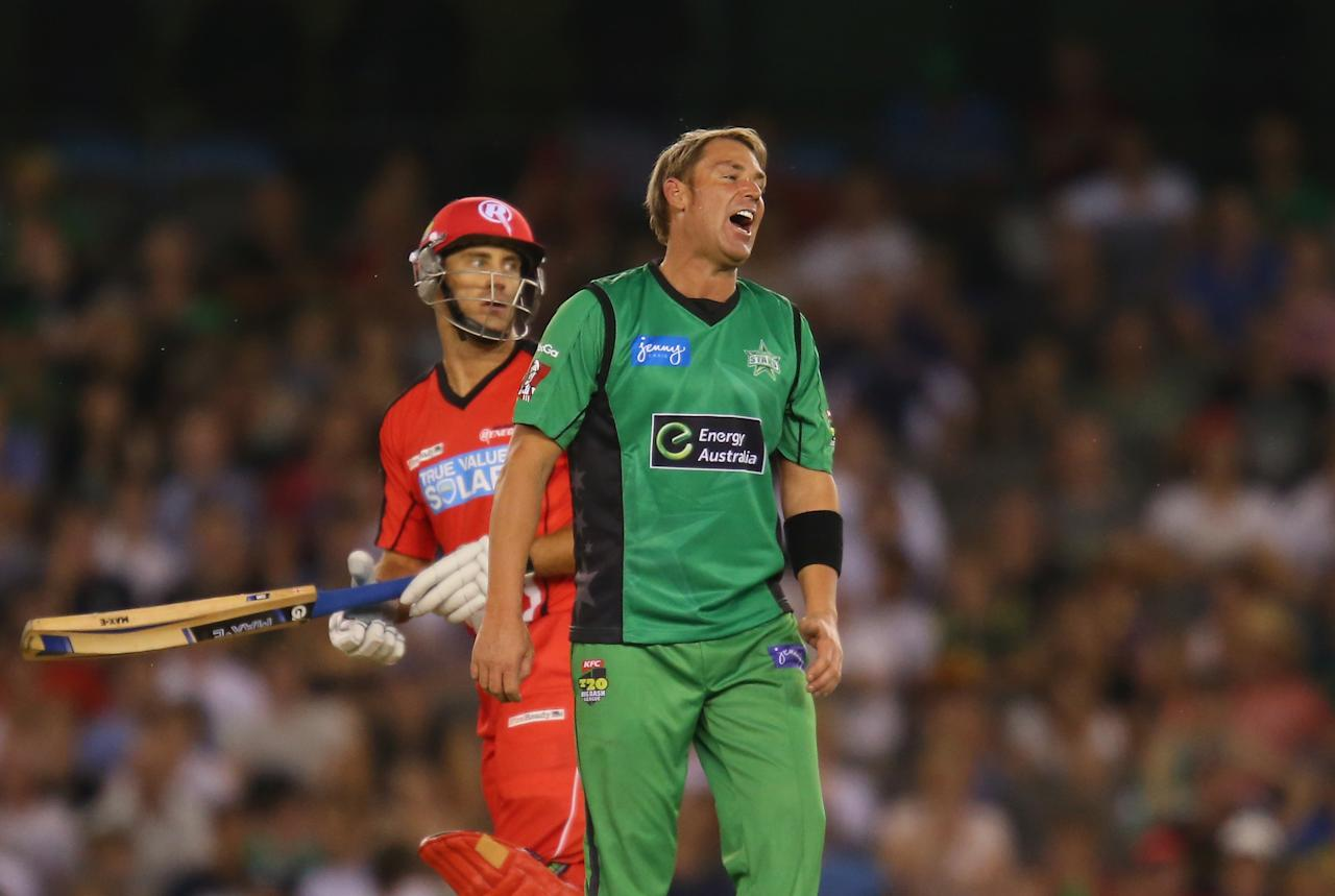 MELBOURNE, AUSTRALIA - DECEMBER 07:  Shane Warne of the Stars reacts after being hit for six by Aaron Finch of the Renegades during the Big Bash League match between the Melbourne Renegades and the Melbourne Stars at Etihad Stadium on December 7, 2012 in Melbourne, Australia.  (Photo by Scott Barbour/Getty Images)