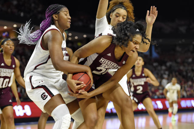 South Carolina's Aliyah Boston, left, and Mississippi State's Yemiyah Morris, right, battle for the ball during a championship match at the Southeastern conference women's NCAA college basketball tournament in Greenville, S.C., Sunday, March 8, 2020. (AP Photo/Richard Shiro)