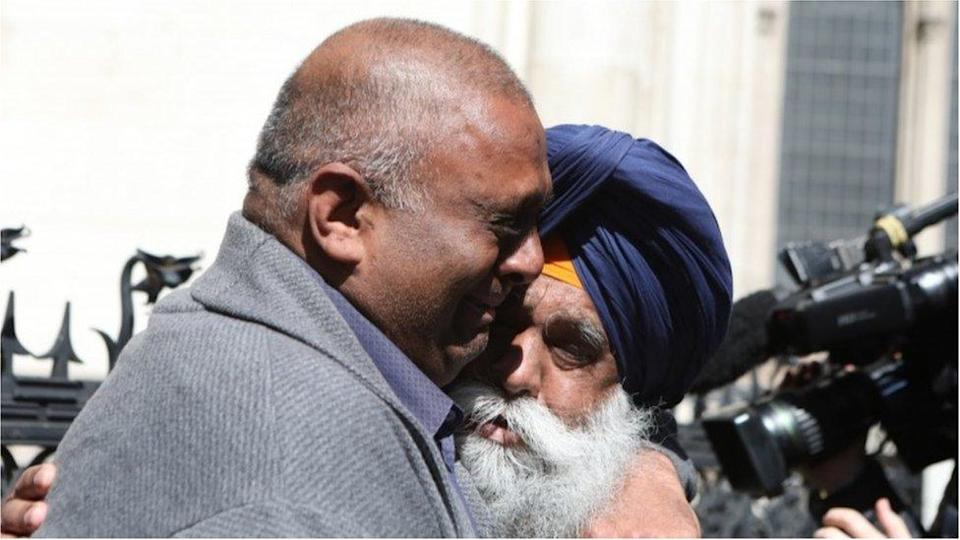 Harjinder Butoy (left) hugs his father outside court
