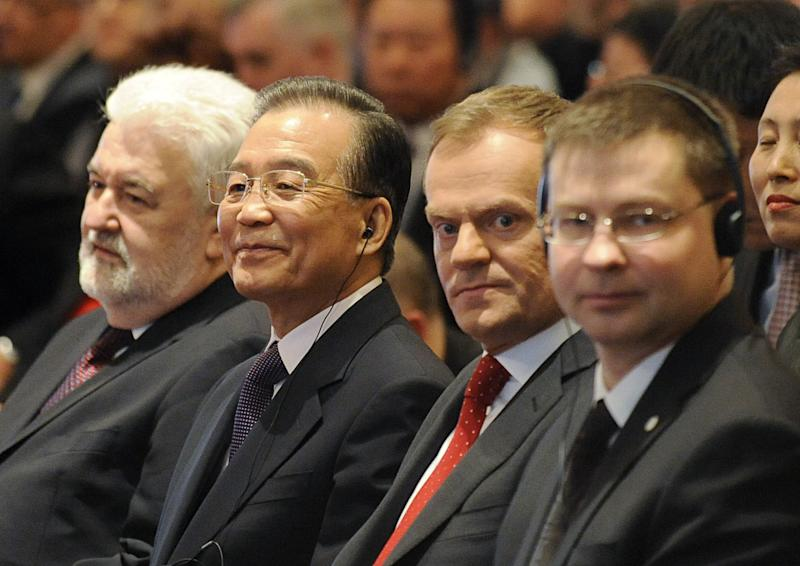 Prime Ministers, from left, of Serbia Mirko Cvetkovic, of China Wen Jiabao, of Poland Donald Tusk and of Latvia Valdis Dombrovskis, attend the opening of the Poland - Central Europe - China Economic Forum in Warsaw, Poland, Thursday, April 26, 2012, on the second day of Wen Jiabao's visit to Poland. (AP Photo/Alik Keplicz)