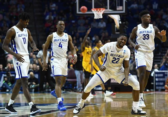 <p>Dontay Caruthers #22 of the Buffalo Bulls celebrates around teammates Jeenathan Williams #11, Davonta Jordan #4, and Nick Perkins #33 during the first half of the first round game of the 2019 NCAA Men's Basketball Tournament against the Arizona State Sun Devils at BOK Center on March 22, 2019 in Tulsa, Oklahoma. </p>