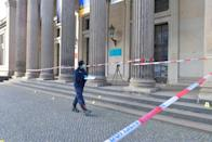 Policewoman walks outside the Green Vault city palace after a robery in Dresden