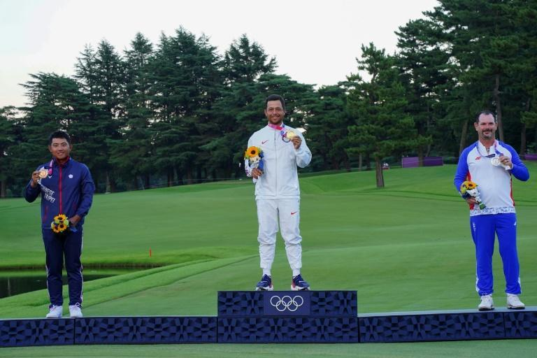 From left: Golf medallists C.T. Pan (bronze), Xander Schauffele (gold) and Rory Sabbatini (silver)