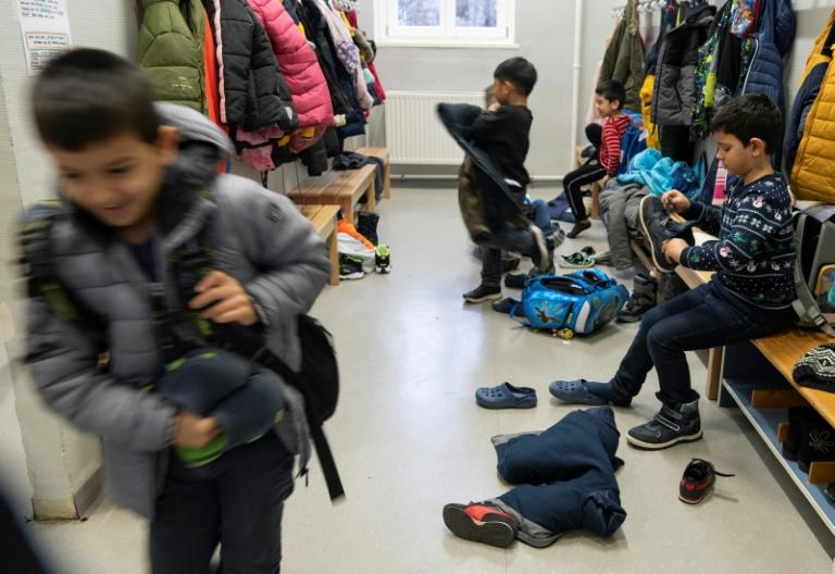 Separating pupils with weak German however has provoked fears of segregation and claims they are 'ghetto classes' (AFP Photo/JOE KLAMAR)