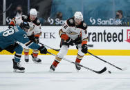 Anaheim Ducks right wing Alexander Volkov (92) skates past San Jose Sharks defenseman Mario Ferraro (38) during the second period of an NHL hockey game, Monday, April 12, 2021, in San Jose, Calif. (AP Photo/Tony Avelar)