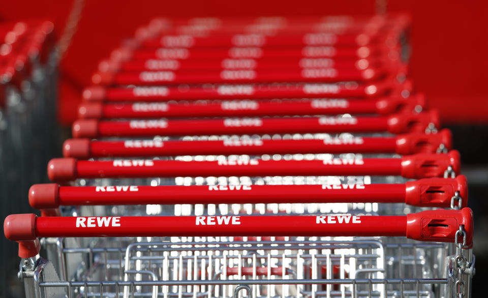 Shopping carts with logos of German supermarket chain Rewe are pictured at a shopping centre in Hanau, Germany, March 17, 2016 Rewe said it would file a complaint to the higher regional court in Duesseldorf after Economy Minister Sigmar Gabriel on Thursday approved a merger of rivals Edeka and Kaiser's. REUTERS/Kai Pfaffenbach  TPX IMAGES OF THE DAY