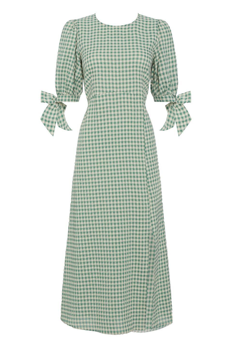 """<p><a class=""""link rapid-noclick-resp"""" href=""""https://www.nobodyschild.com/clothing/dresses/midi-dresses/green-textured-gingham-esme-midi-dress.html"""" rel=""""nofollow noopener"""" target=""""_blank"""" data-ylk=""""slk:SHOP NOW"""">SHOP NOW</a></p><p>Consider this Nobody's Child dress a summer classic. Its flattering silhouette, sweet bow sleeves and muted green gingham make it feminine without feeling saccharine. We'd team it with a pair of trainers and a basket bag.</p><p>Esme midi dress, £45, <a href=""""https://www.nobodyschild.com/clothing/dresses/midi-dresses/green-textured-gingham-esme-midi-dress.html"""" rel=""""nofollow noopener"""" target=""""_blank"""" data-ylk=""""slk:Nobody's Child"""" class=""""link rapid-noclick-resp"""">Nobody's Child</a></p>"""