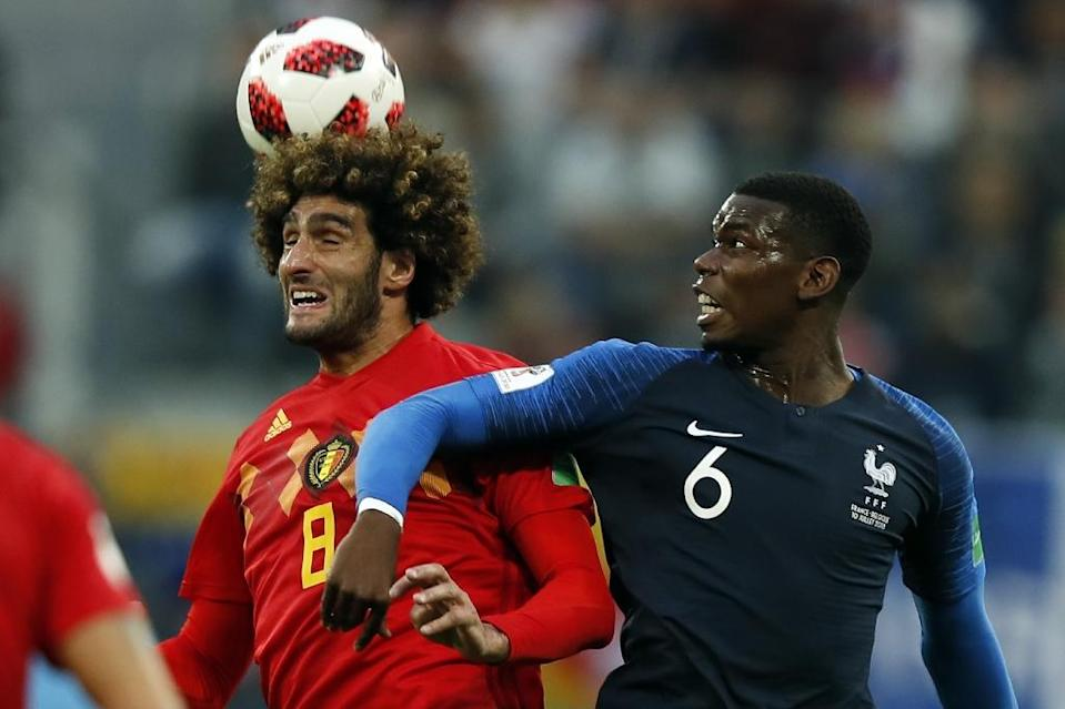 Physical battle: Paul Pogba (right) in action against Manchester United teammate Marouane Fellaini in the France v Belgium World Cup semi-final (AFP Photo/Odd ANDERSEN)